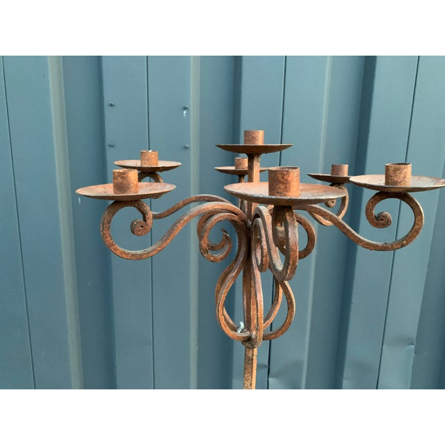Traditional style rustic iron candelabra with adjustable height.