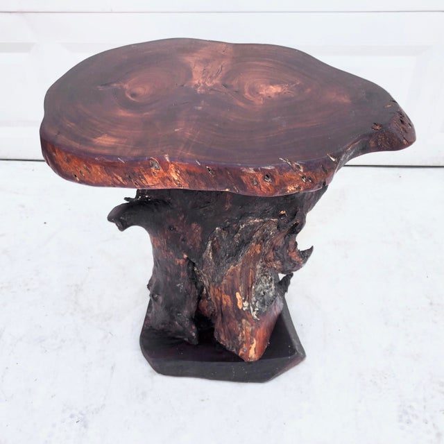 This primitive tree slab pedestal table features uniquely shaped Rosewood slab, tree trunk base, and one of a kind live...