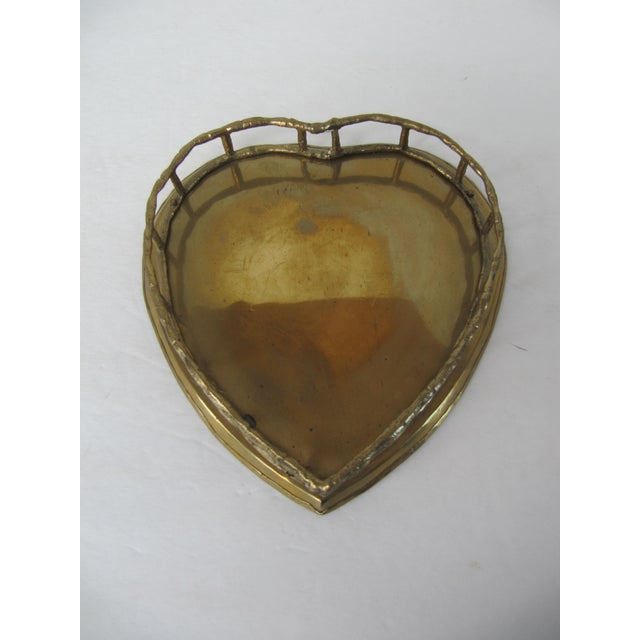 Small brass heart shaped tray. This would be great on a vanity for your favorite perfume or to hold jewelry. Also great as...