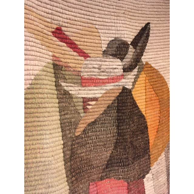 This vintage handwoven hand-dyed Peruvian throw or a wall tapestry featuring three women in hats in front of mountains....