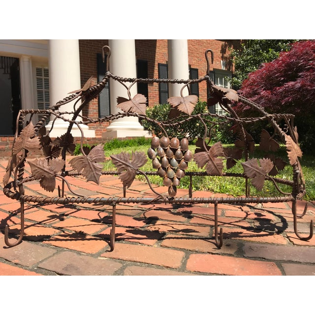 Custom crafted enchanting wrought iron grape vine pot rack. Fashioned with nine large hooks for holding multiple pots and...