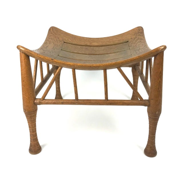Egyptian revival Thebes stool in oak probably made by Liberty & Co., circa 1920's. Bentwood slatted top upon turned legs...