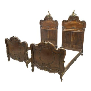Early 1900s Italian Louis XV Style Carved Walnut Beds Set of Two For Sale