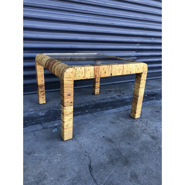Vintage wrapped rattan square side table. Caning wrapped table with simple rounded shape. Brings a little streamlined...