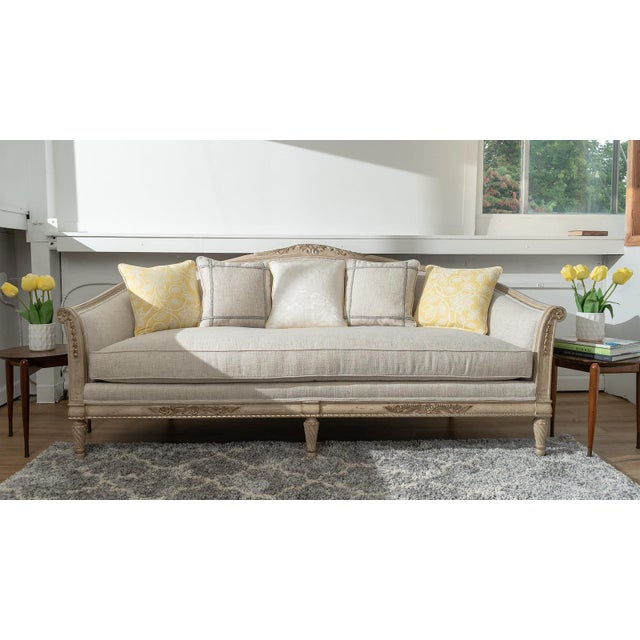 Exquisite French Provincial cabriole style sofa with distressed paint finish and decorative carvings. The frame is solid...