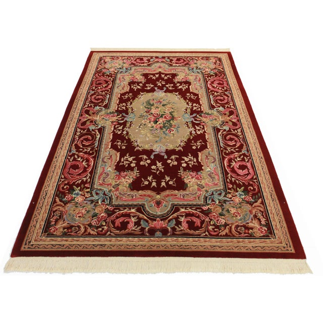 Stunning Chinese rug in brownish reds and berry pinks. Hand-knotted of wool. Features a charming Aubusson design.
