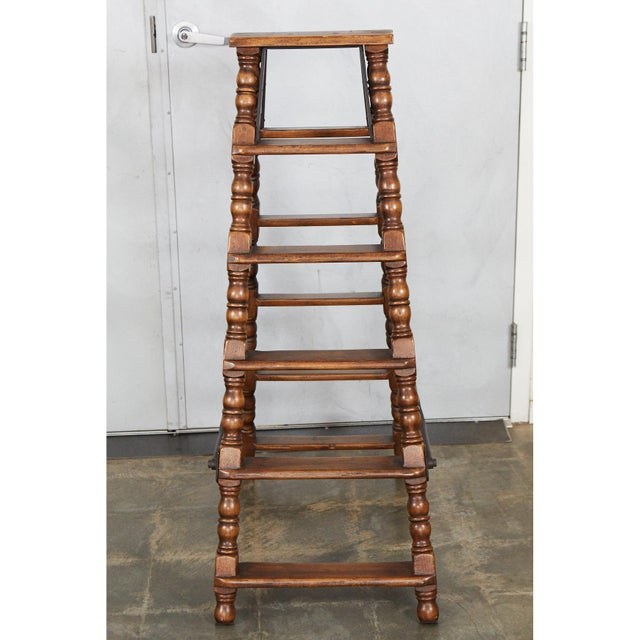 We believe this ladder was made 1950's in the Jacobean style with nicely turned elements. The ladder has solid...