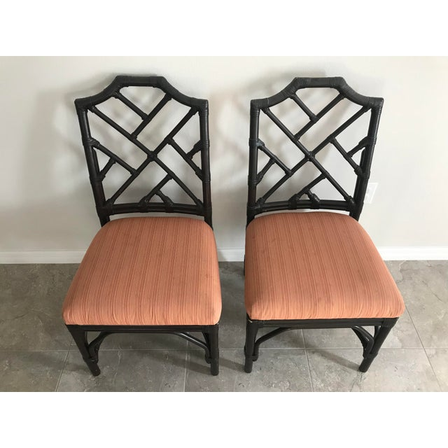 Pair of classic Chippendale bamboo side chairs with upholstered seats. They have minor scuffs and scrapes to the finish...