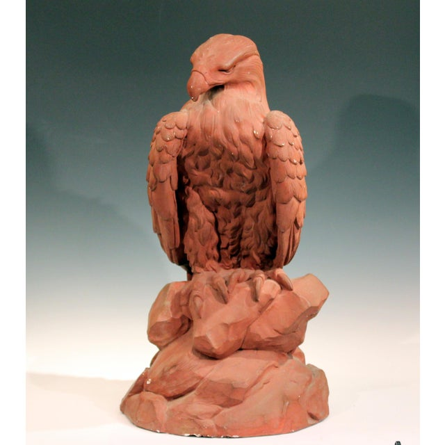 Large painted plaster eagle sculpture, circa mid-20th century. Excellent rendering of the majestic bird perched on a rock...