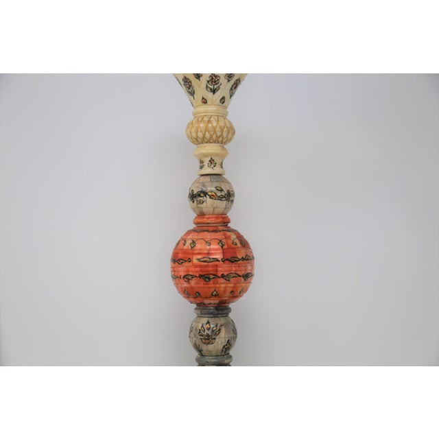 Possibly a lamp or candle holder at one time, this intricately detailed vessel is a beautiful accessory for any tall...
