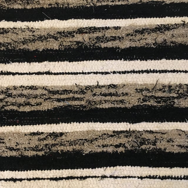 Gorgeous 100% recycled and handwoven cotton rug. Made in Johannesburg in a sustainable, zero-carbon-footprint community....