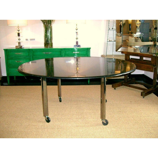 Vintage Joe D'Urso polished granite table, chrome legs, on casters, for Knoll with metal label and Hand Signed by Joe...