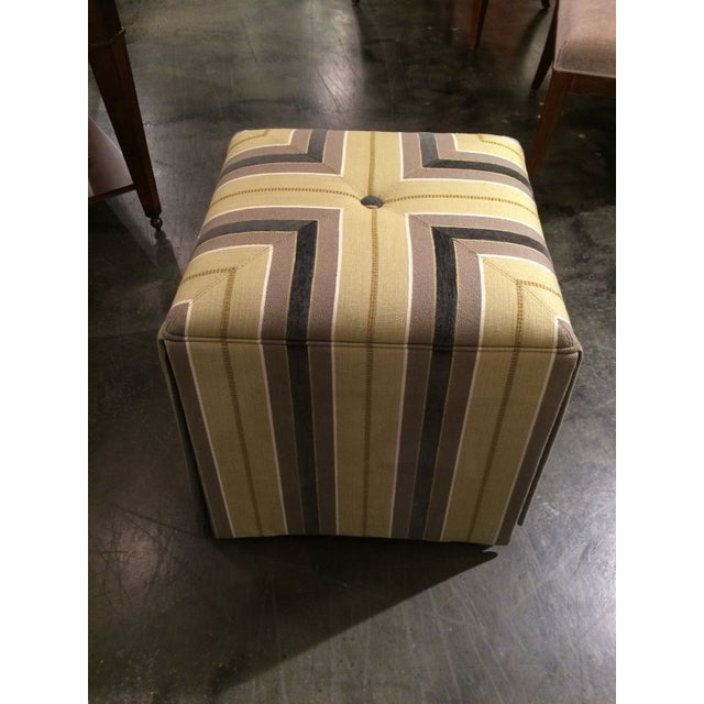 These well-scaled ottomans are beautifully upholstered in a mustard, brown and black striped fabric. They can be placed...