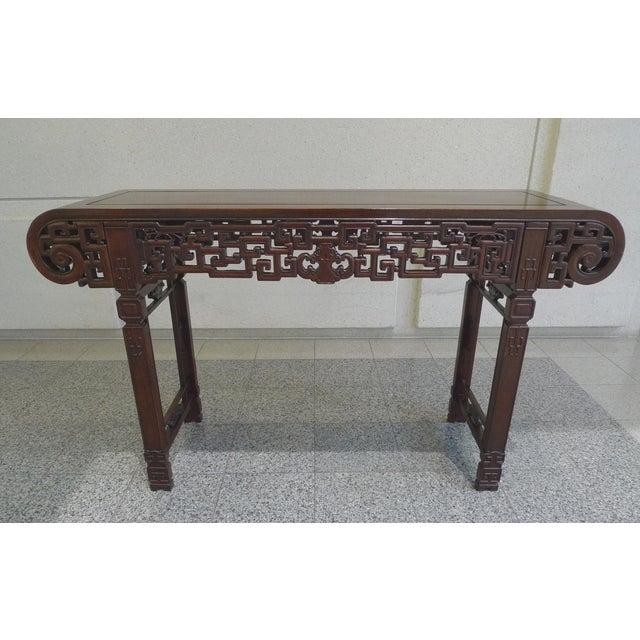 This vintage Asian altar table is crafted from elmwood and coated with a dark finish. The table has clean straight lines...
