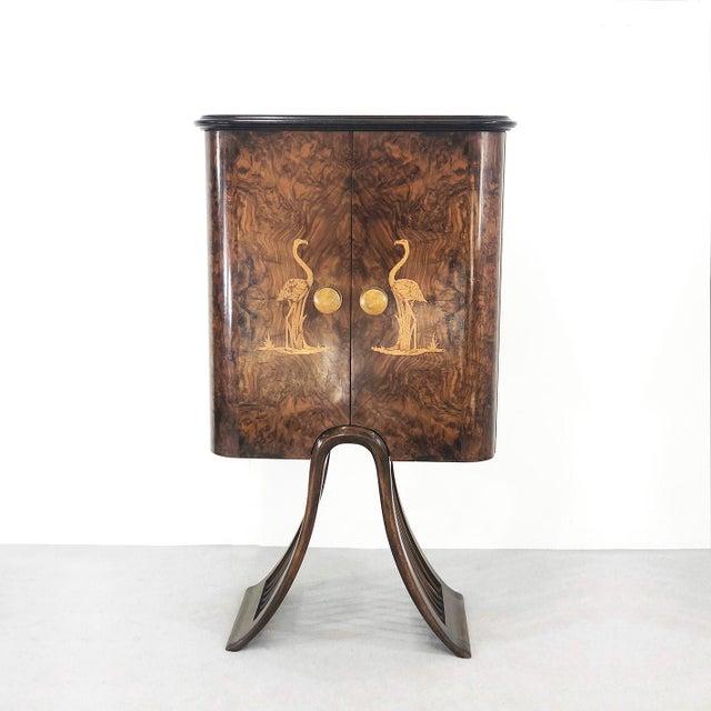 Luigi Scremin cabinet of 1940. The cabinet is in ebony veneer. In various veneered woods. The two swans depicted are made...