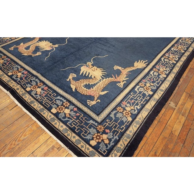Antique Chinese Peking Rug with a blue background.
