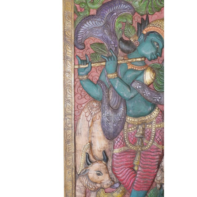 Indian carved wood wall panels of Krishna playing flute with his cow from India. Cows and Krishna have always been...