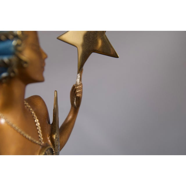 This extraordinary Art deco bronze is only one of an exquisite grouping of pieces by Erté we've just received... Romaine...