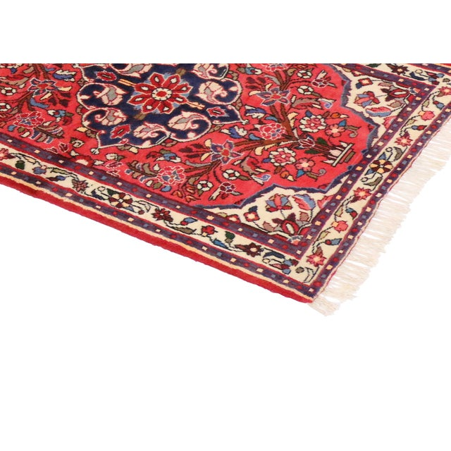 Hand-knotted wool vintage Persian Rudbar carpet runner featuring three medallions with an allover floral pattern...