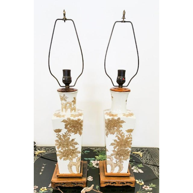 Beautiful Oriental Lamps, with great gold tones and wood carved bases. The lamps are signed and excellent conidtion.