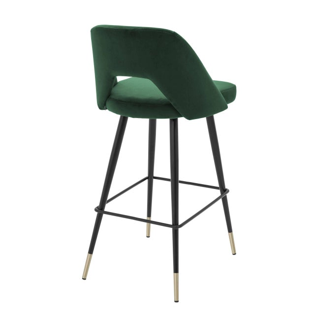 Bring Mid-Century Modern style into your home with the Avorio Bar Stool. Featuring a Roche green velvet upholstered seat...