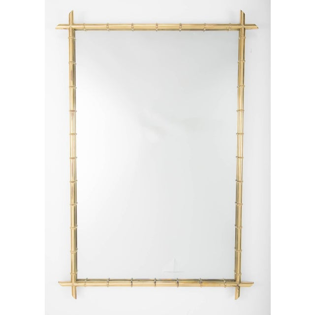 Hollywood Regency faux bamboo brass mirror in the style of Billy Haines. Good scale, 4 feet by 33 inches.