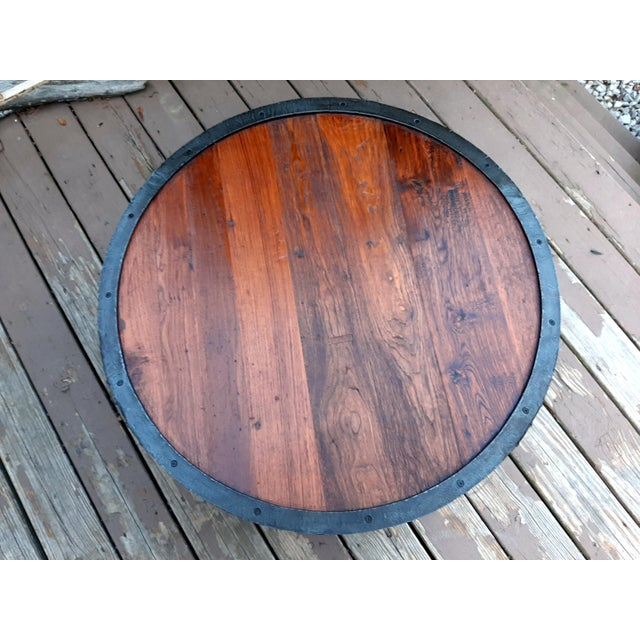 Item offered is a handcrafted hand forged artisan round coffee table with 2 tiers of reclaimed Chestnut wood platforms. It...