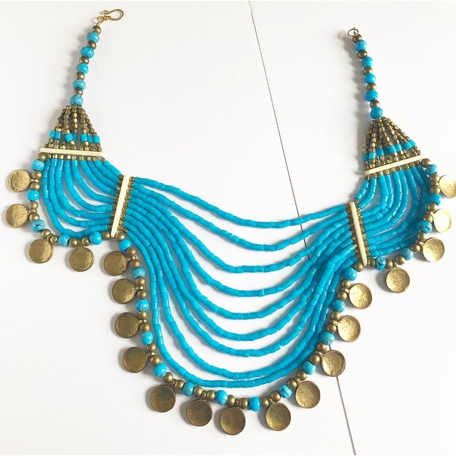 Fabulous Large scale costume statement necklace with turquoise colored multi-strands with gold colored bead accents and...