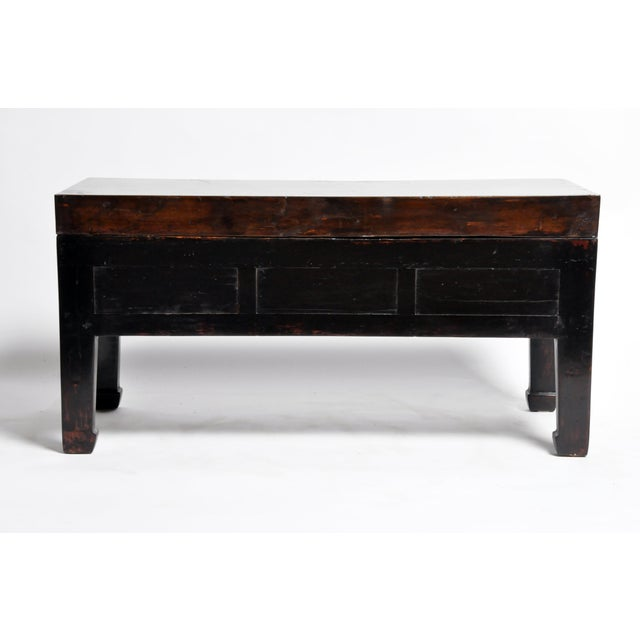 This handsome low table is from Jiangsu, China and was made from reclaimed elm wood and terracotta. The piece features...