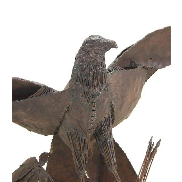 Awesome vintage American Bald Eagle sculpture made of welded pieced steel. The eagle with wings outstretched, holds a...