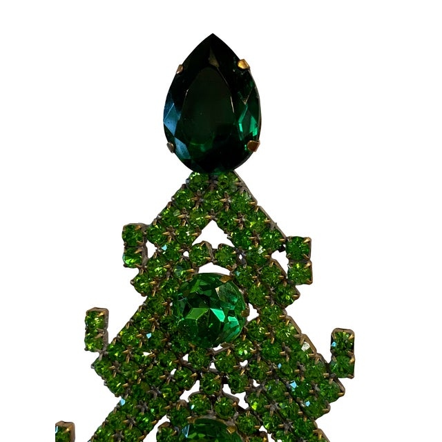 A Czechoslovakia rhinestone Christmas tree with beautiful emerald green colored crystals in various sizes. Some forming...