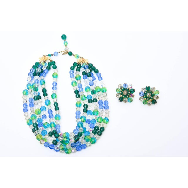 The colors of the sea in alternating glass beads of blues and greens make up this signed Elsa Schiaparelli vintage...