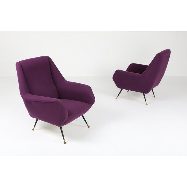Italian pair of arm chairs, by Ico Parisi, purple fabric. Black metal legs which end on brass round feet. 1950s Italian...