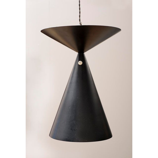 A rare pendant design by Bertil Brisborg in Sweden, circa 1950, for Nordiska Kompaniet. This handsome lamp was produced in...