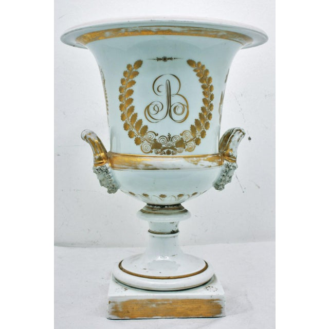 A rare Paris porcelain French large urn commemorating Napoleon Bonaparte, circa 1840. The piece is particularly special...