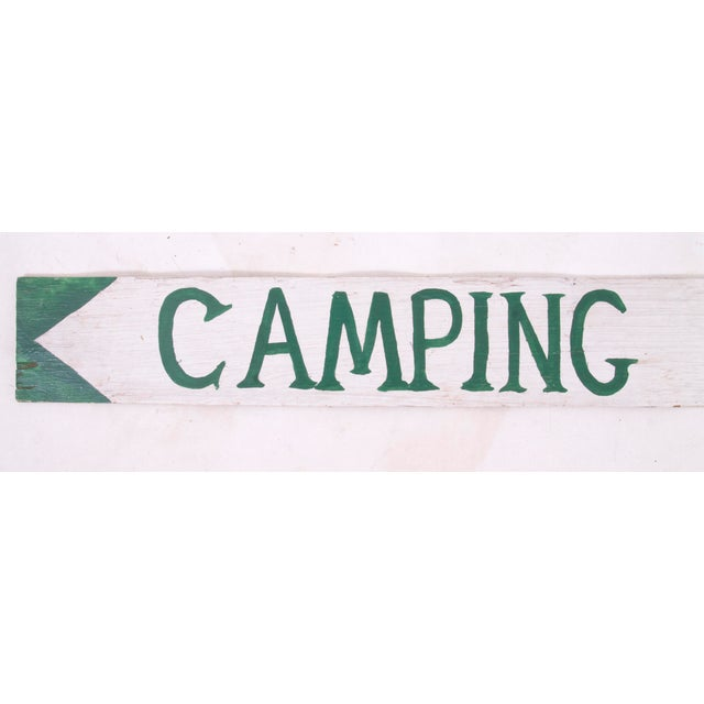 """Vintage one-sided hand-lettered plywood """"Camping"""" sign with arrow. Age wear, paint loss, chips, scratches."""