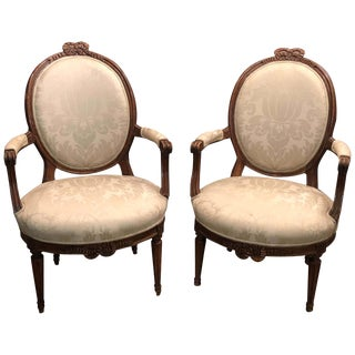 Pair of Louis XVI Carved Bowknot Fauteuils For Sale