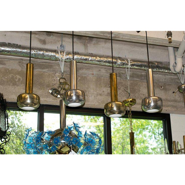 A midcentury set designed in 1956 by architect Vilhelm Lauritzen for Louis Poulsen. A pair of brass-plated pendants...