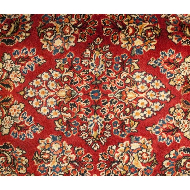 An early 20th century Persian Sarouk runner with wonderful mirrored tree of life pattern on a deep ruby background,...