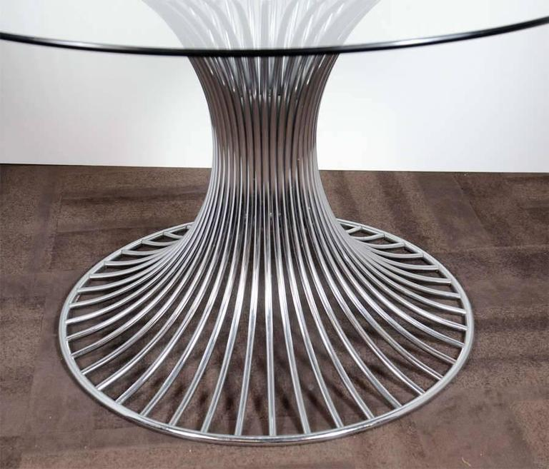 high-end mid-century modern round dining table with sculptural