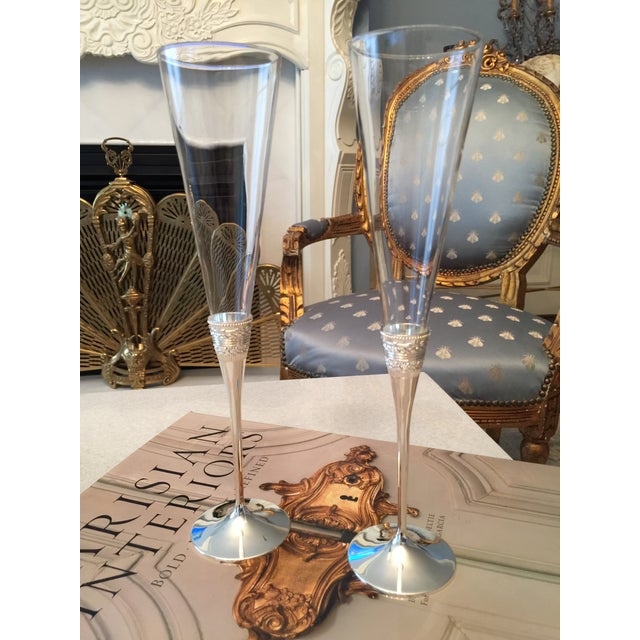 """Set of two Vera Wang for Wedgewood toasting flutes in silver-plate. New; complete with gift box. 2.5"""" Diameter x 10.5""""..."""