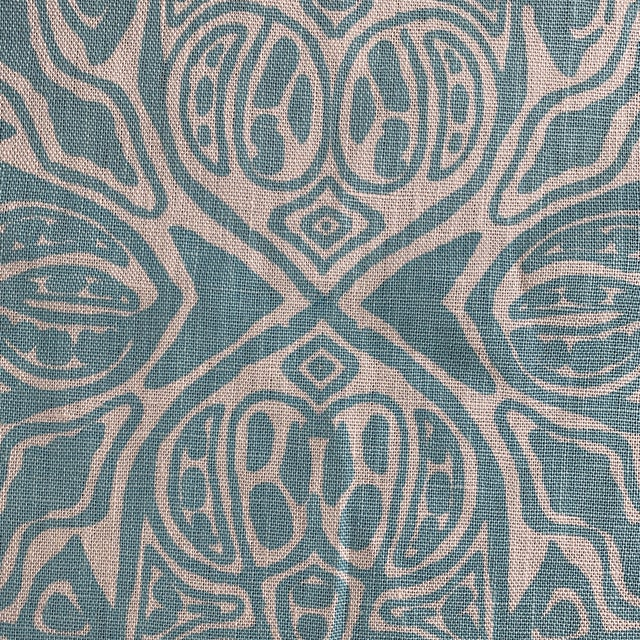 A gorgeous quadrille hand printed linen fabric in turquoise on tint. Listing is per yard-there are a total of 9 yards...