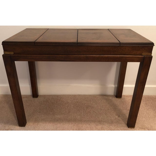 This simply fabulous Mid-Century Campaign style backgammon console table is made by Lane Furniture Company. Banded highly...
