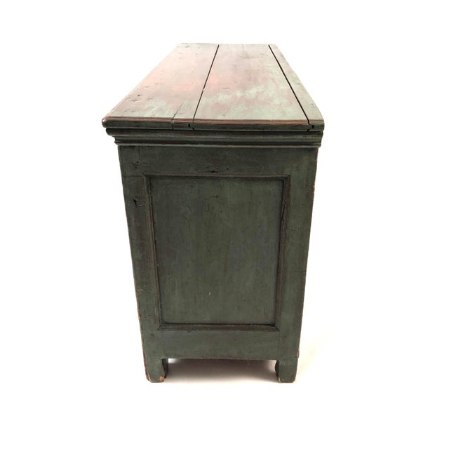 An antique French Canadian country side cabinet in beautiful old green paint, of rectangular form with two cupboard doors,...