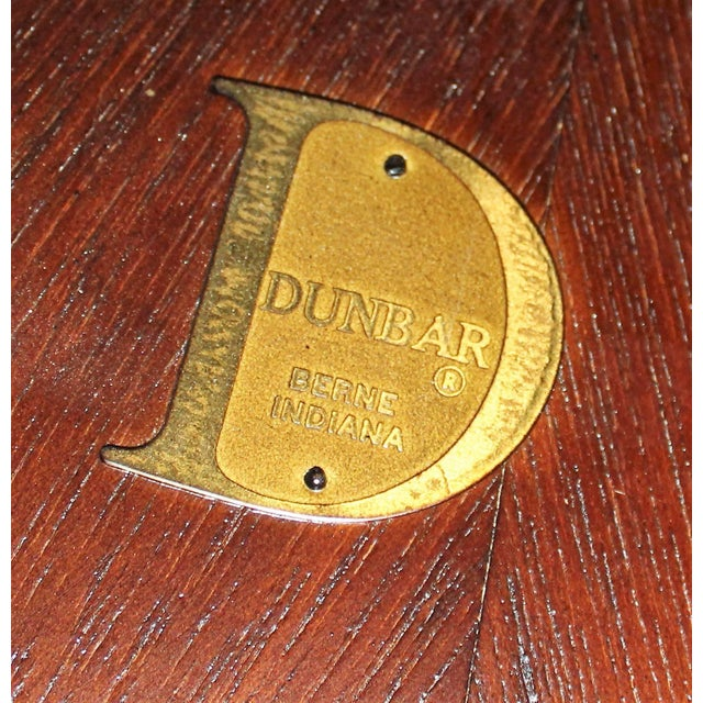 Beautiful very rare Dunbar round dining or conference table, top has a bull-nose edge with a brass ring inlay on top. Top...