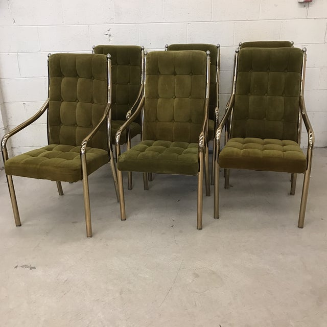 70s style avocado green velvet upholstery on brass frames. All chairs have arms. Brass is heavily patina'd, but these have...