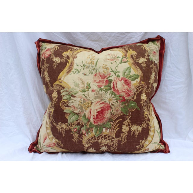 This contemporary English floral style down-filled pillow has a lovely brown, gold, red, and green floral print on linen...