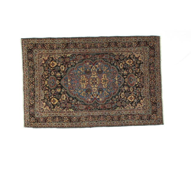 Wool pile hand made antique Persian Dorokhsh rug.