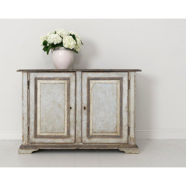 An incredible early 19th century Italian buffet sideboard, circa 1820, in original paint found in Abruzzo, Italy. The...
