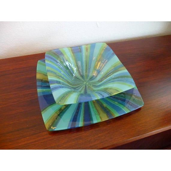 Higgins fused glass tray and bowl set. Both pieces are incredibly vibrant and shiny in a psychedelic yellows, blues, and...